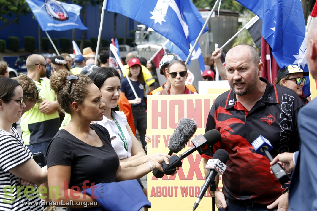 Damien Davie addresses media at rally