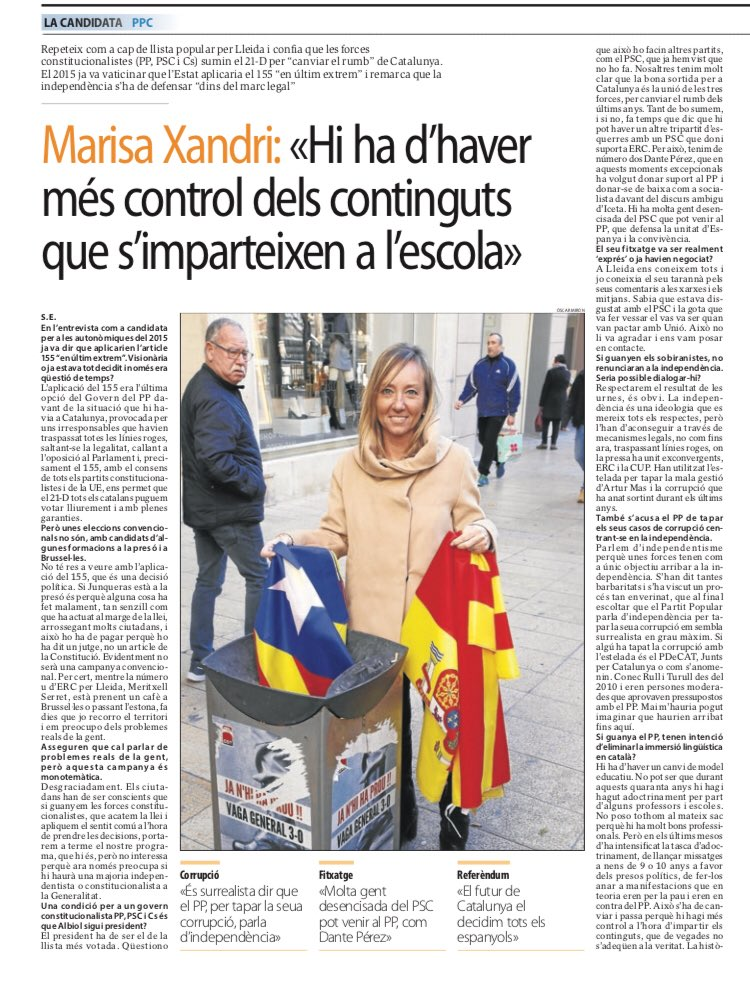 Marisa Xandri, PP candidtae for Lleida, sticks estelada in waste paper bin