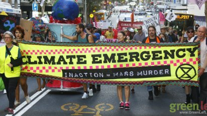 Climate Emergency banner leads the march