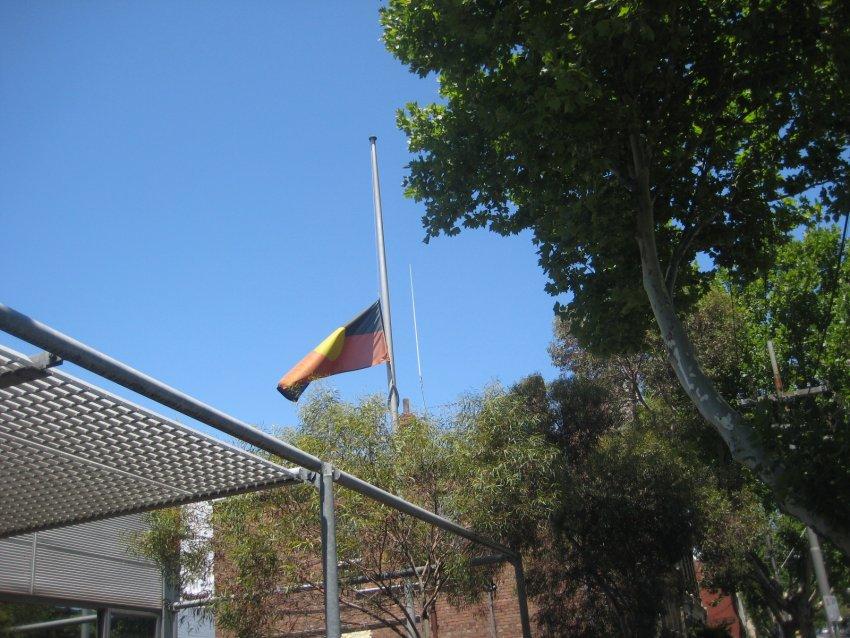 An Aboriginal flag flying at half mast.Photo: Kazadams/Wikimedia Commons