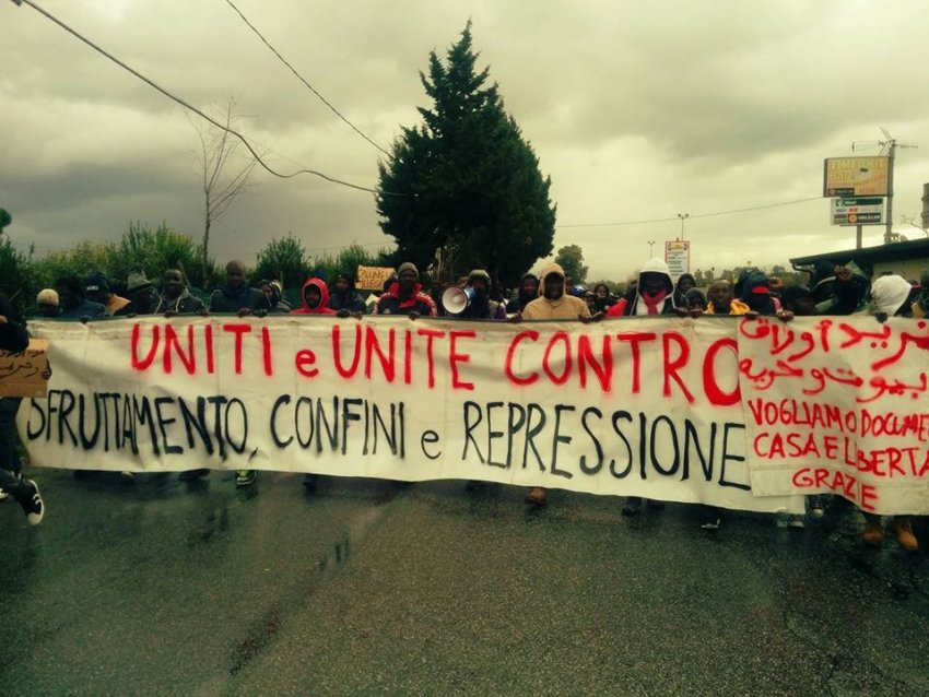"'Illegal' migrants protest in Regio Calabria: ""Men and women united against exploitation, lockdown and repression"" (Credit: Facebook)"