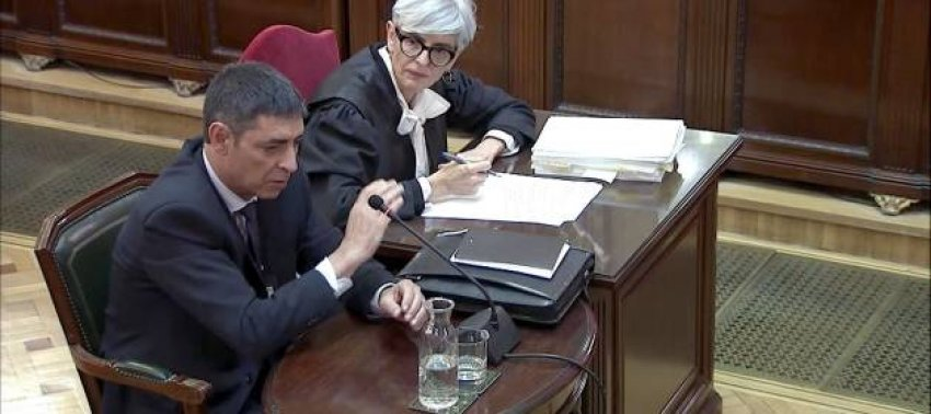 Former Catalan police chief Josep Lluís Trapero, who is facing charges in the National High Court for rebellion and sedition, testifies under the gaze of his defence counsel, Olga Tubau