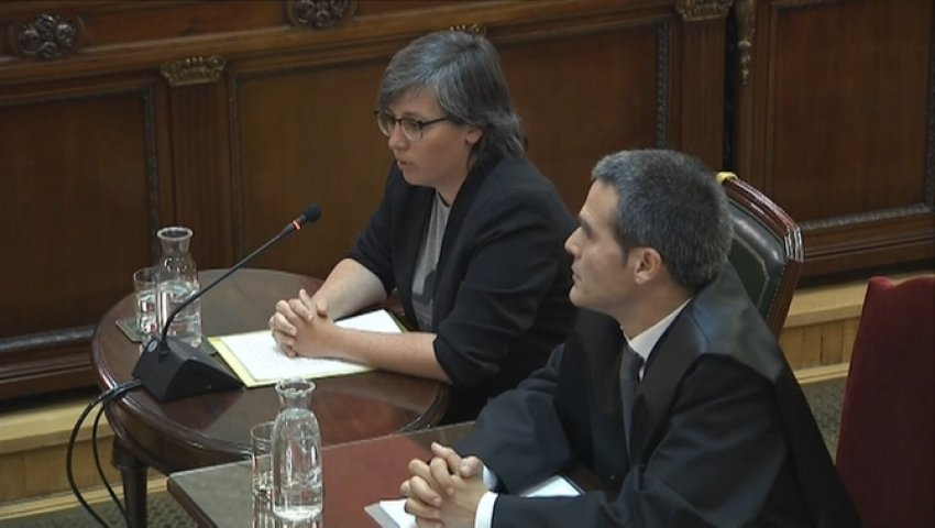 Former CUP MP Mireia Boya, accompanied by her lawyer, gives evidence