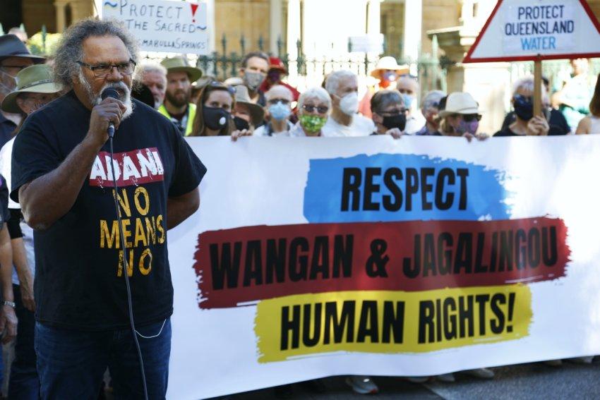 Wangan and Jagalingou senior cultural custodian Adrian Burragubba speaks to the crowd