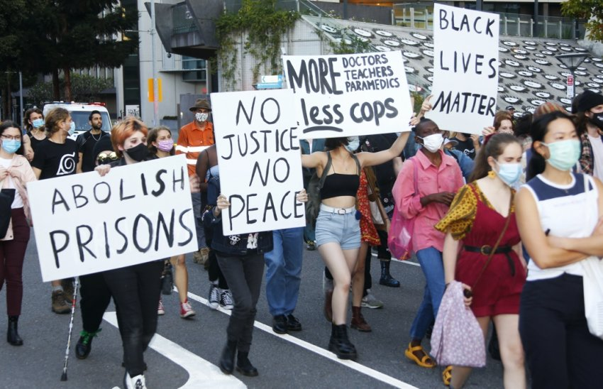 Signs in the march: No justice no peace