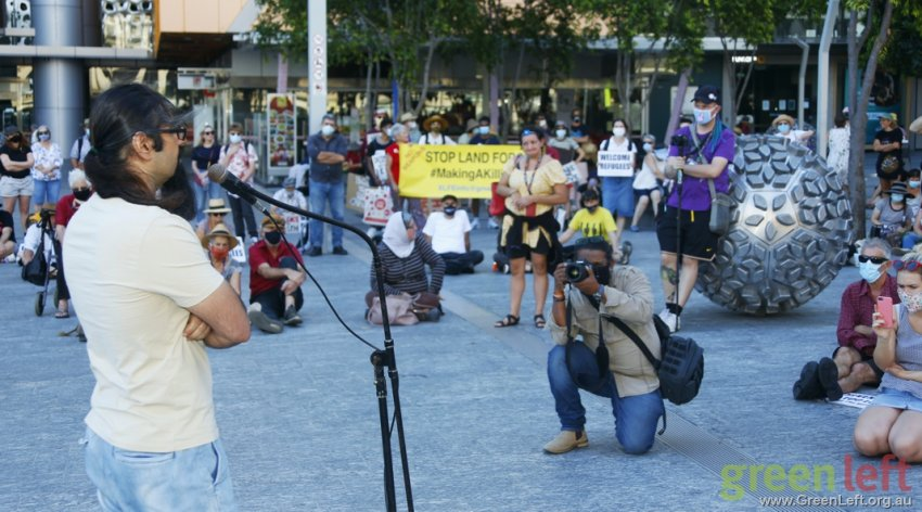 Released refugee Kazem speaks to Brisbane rally. Photo: Alex Bainbridge