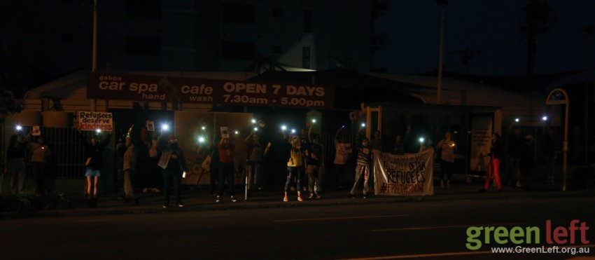 Candlelight vigil at the end of the action