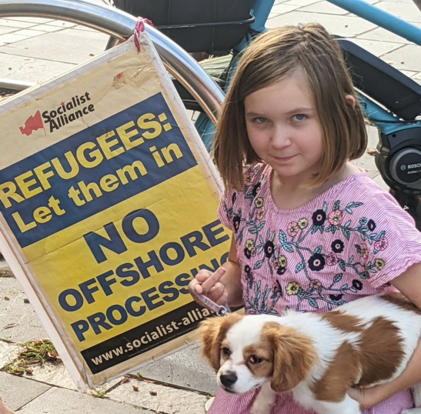 Palm Sunday in Newcastle - Milla with her dog Lorelei. Photo: Amand Perram
