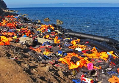 Discarded lifejackets on a Mediterranean coastline. Photo: Pixabay