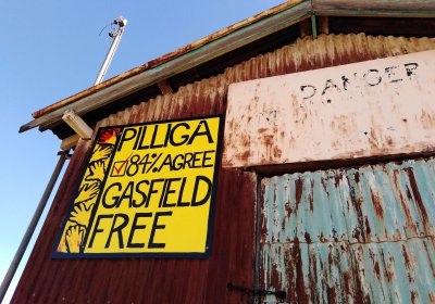 An anti-coal seam gas mural on a building in Pilliga township.