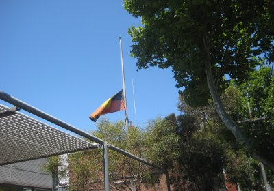 An Aboriginal flag flying at half mast.Photo: Kazadams/Wikimedia Commons