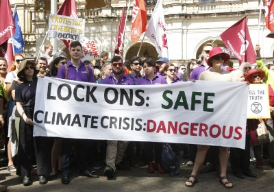 A banner at the Protect the Right to Peaceful Protest rally in Brisbane on October 22.