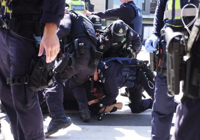 Police arrest a protester at Blockade IMARC in Melbourne on October 30.