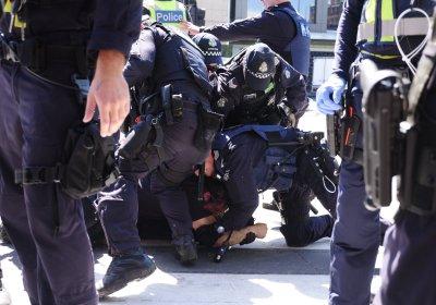 Police arrest a protester at Blockade IMARC in Melbourne on October 30.