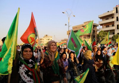 Demonstrators celebrate the anniversary of the Rojava Revolution.