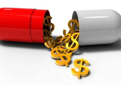 pill with money spilliing out