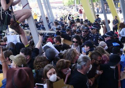 Police spray chemical foam at anti-IMARC protesters