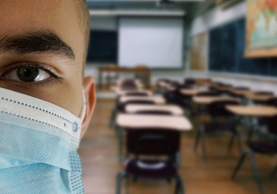 Child wearing a mask in a classroom