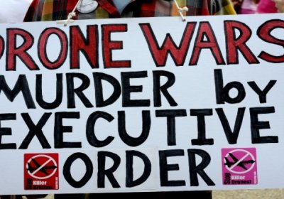 A placard condemns Obama's drone wars.