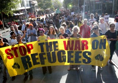 Stop the war on refugees banner at rally