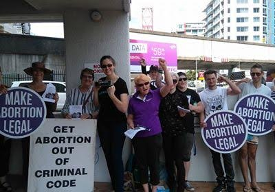 Group of women holding pro-choice placards