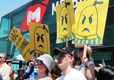 Angry Bananas in Pajamas on placards at rally against cuts
