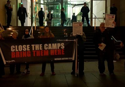 Refugee activists outside the Sydney Insitute.
