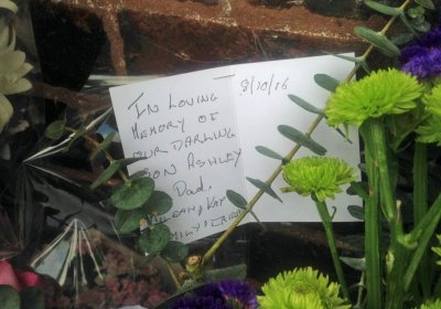 A card left by  the family of Ashley Morris, one of two workers killed at the Eagle Farm Racecourse when a concrete slab fell on them on October 7.