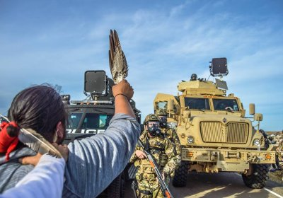A water protector at Standing Rock defies the militarised police.