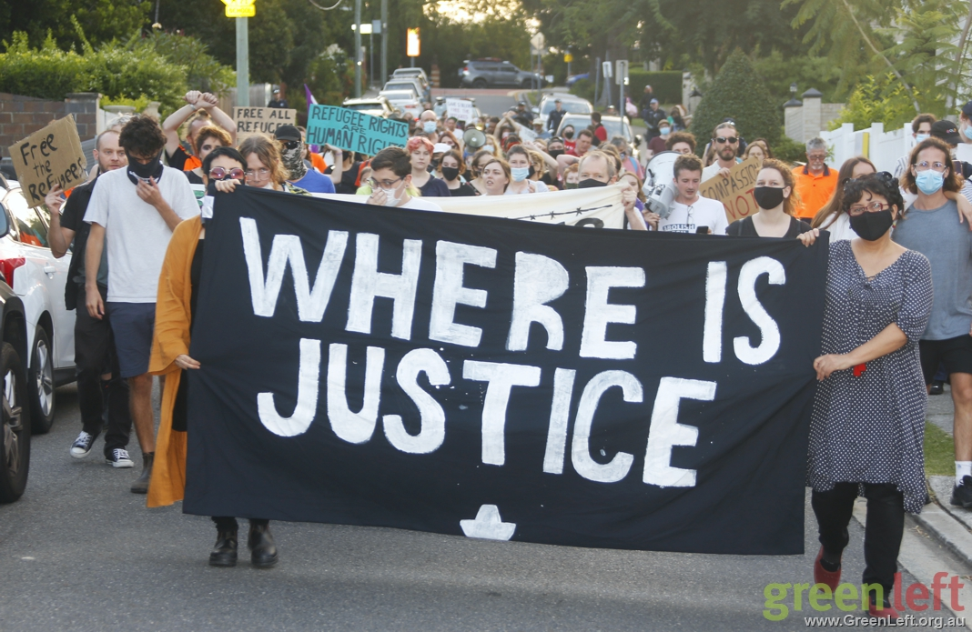 "Refugee rights banner reading ""Where is justice?"""